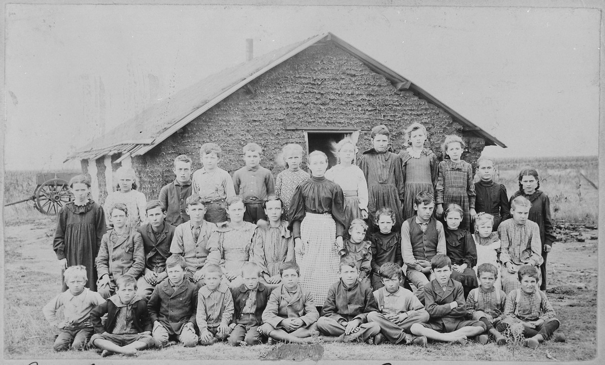 Teacher and children in front of sod schoolhouse. Woods Co., Okla. Terr., ca. 1895 - NARA - 516448.tif