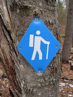 Blue diamond-shaped sign used to designate hik...