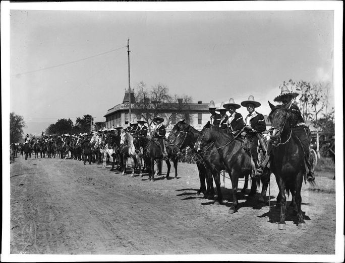 Mexican caballeros lined up for La Fiesta de Los Angeles in, 1903 (CHS-1451)