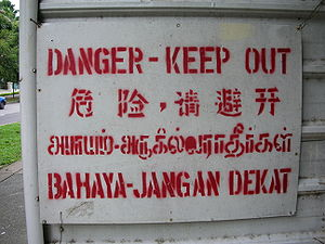 Quadrilingual warning sign in Singapore. The t...