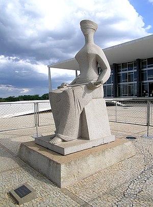 A Justiça by Alfredo Ceschiatti. Seated, blind...