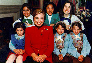 Hillary Clinton posing with Girl Scouts