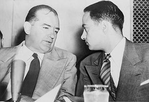 English: Sen. Joseph McCarthy chats with his a...