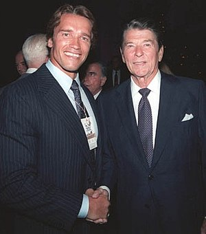 President Reagan having a photo taken with Arn...