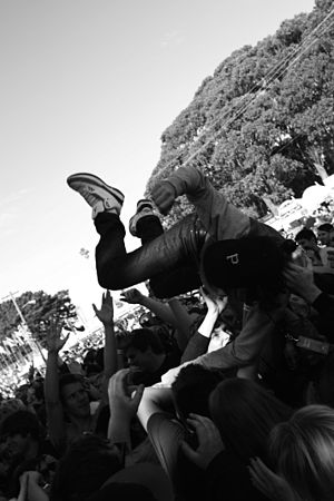 A member of the audience crowd surfing at a Da...