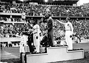 African-American Jesse Owens on the podium aft...