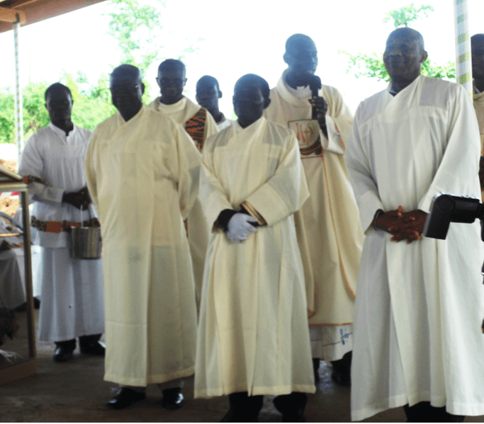 Photo of Catholic eucharistic Ministers in vestments