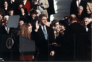 English: Bill Clinton, standing between Hillar...