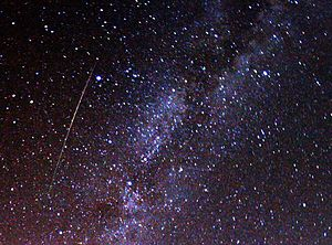 A multicolored, long Perseid meteor striking t...