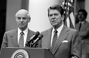 President Reagan with William French Smith mak...