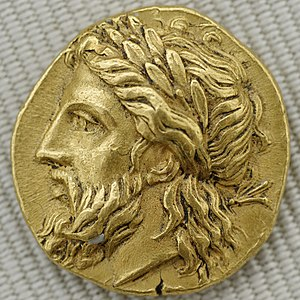 Zeus with a laurel crown. Gold stater from Lam...