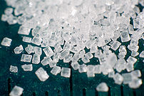 Macro photograph of a pile of sugar (saccharose)