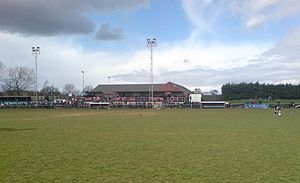 English: A photo of the main stand at Woodford...