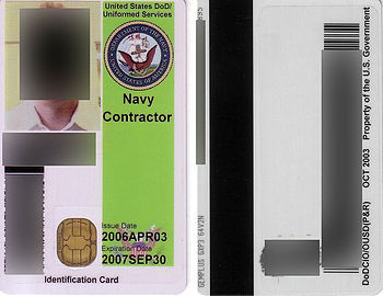 A Common Access Card, with personal data redacted.