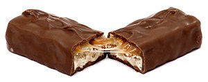English: A Snickers candy bar, broken in half.