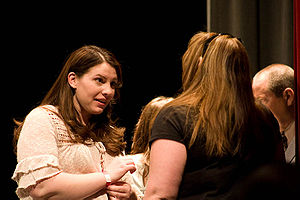 Stephenie Meyer talks with one of the winners ...