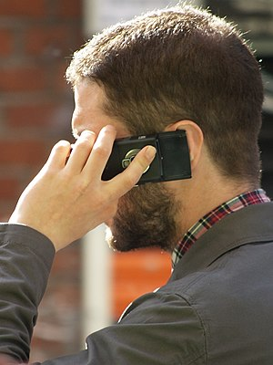 A man speaking on a mobile telephone