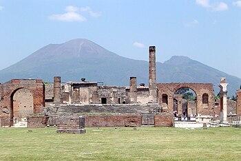 English: Pompeii, with Vesuvius towering above.