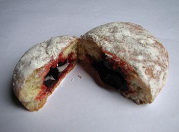 A photo of a jelly doughnut (aka Berliner) top...