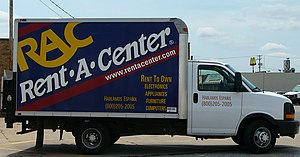 A Rent-A-Center truck photographed in a public...