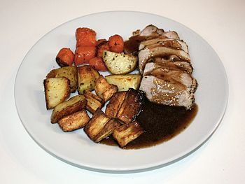 English: Sunday pork roast dinner served with ...