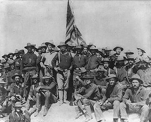 Col Theodore Roosevelt stands triumphant on Sa...