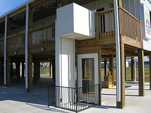 Wheelchair elevator located outdoors.