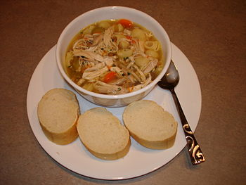 A homemade chicken noodle soup with bread