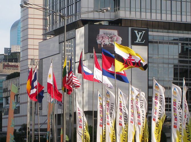 English: The flags of ASEAN nations raised in ...