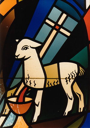 Stained glass showing Lamb of God with vexillu...