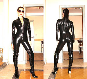 Girl wearing a black latex catsuit by House of...