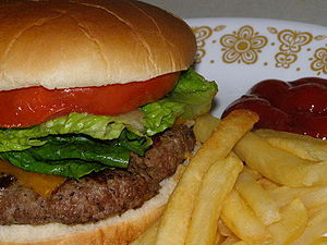Homemade cheeseburger with french fries.