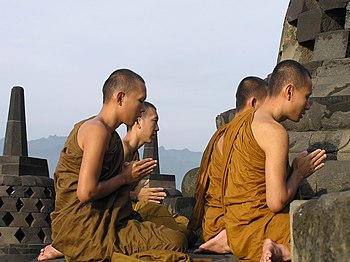 English: Buddist monks praying at Borobudur, c...