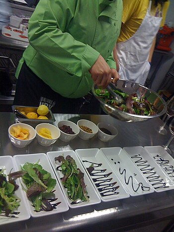 A chef preparing a salad