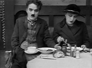 Chaplin with Edna Purviance in The Immigrant (...