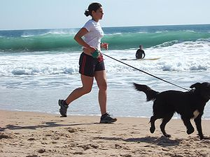 Jogging with dog at Carcavelos Beach