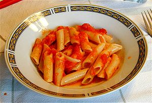 Penne pasta served with tomato sauce