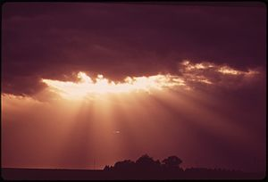 SUN RAYS THROUGH STORM CLOUDS OVER GRAFTON, IN...