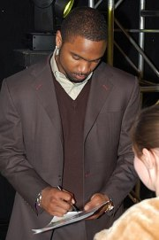 Charles Woodson signing an autograph