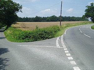 Fork in the road. To the left is Cherry Lane. ...