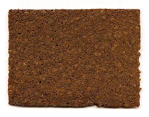 A slice of pumpernickel rye bread