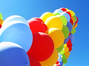 An arch of colourful party balloons.