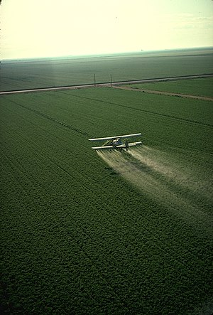 Spraying pesticide in California