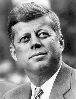 John F. Kennedy, White House photo portrait, looking up