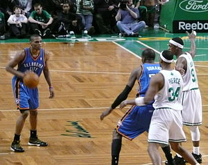 Russell Westbrook dribbling the ball during Ok...