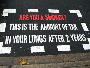 An anti-smoking message painted on a pedestria...