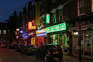 English: The streets of Brick Lane at night in...