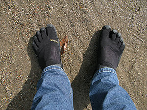 Man wearing a pair of black Vibram FiveFingers...
