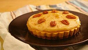 Vegan pumpkin pie with pecans.