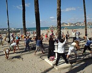 exercising on Benidorm beach